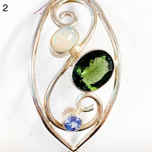 Moldavite and opal, tanzanite